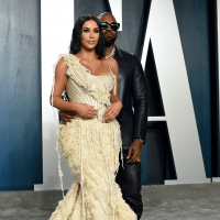 https://www.gambleonline.co/app/uploads/2021/03/kim-kardashian-and-kanye-west-vanity-fair-afterparty-1.png